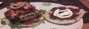 Food blog Cheese and bacon hamburger with caramelized onions