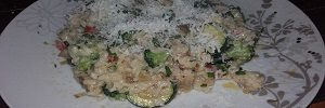 Food Blog Vegetarian risotto with zucchini, broccoli florets, paprika and onions with Parmesan on top